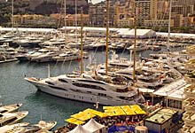Yacht Photography Monaco Yacht Show, Port Hercule in Monaco, in the foreground Superyacht Wind with Helicopter